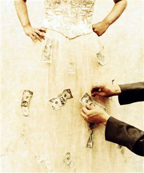 pinning money on a wedding dress