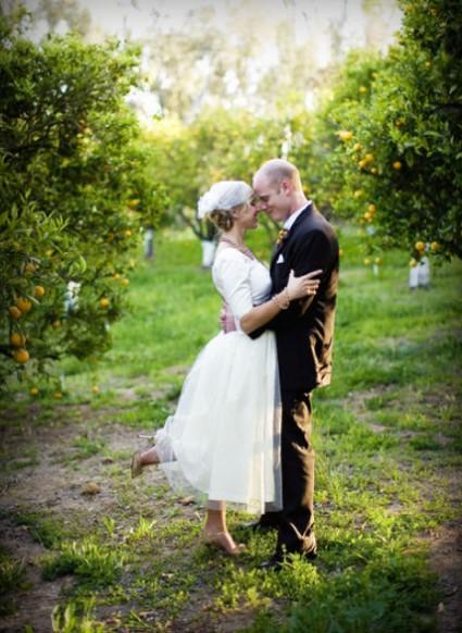 Vintage inspired bird wedding Bride and groom embrace