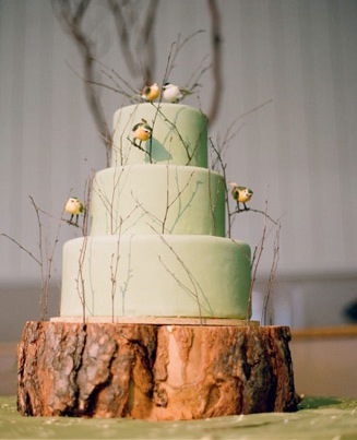 Wedding cake on wood stand decorated with birds and twigs