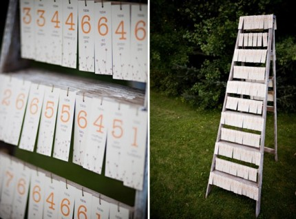 Escort cards on an old ladder