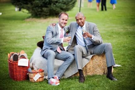 Wedding guests sit on hay bales