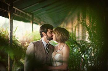 short haired bride kisses her groom