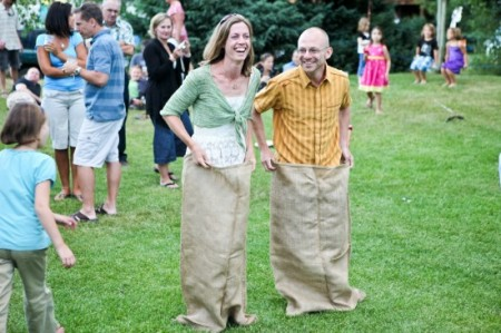 wedding guests participate in a sack race