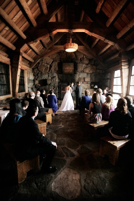 Mountain wedding in front of a stone alter