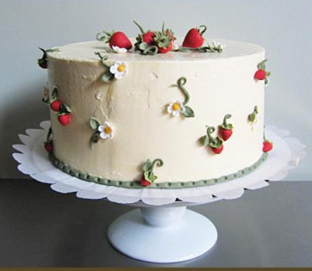 Simple wedding cake with gum paste strawberries and strawberry blossoms