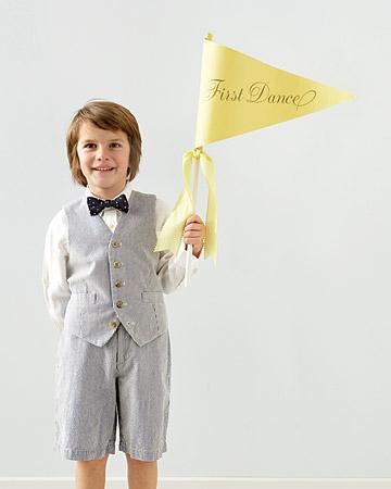 little boy holding a yellow pendant