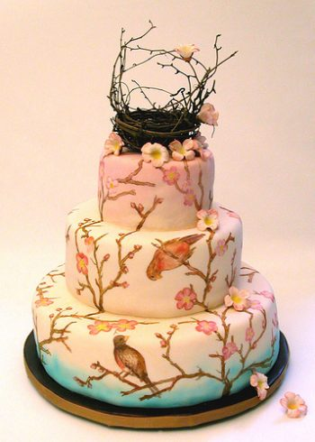 Painted cake with cherry blossoms and birds