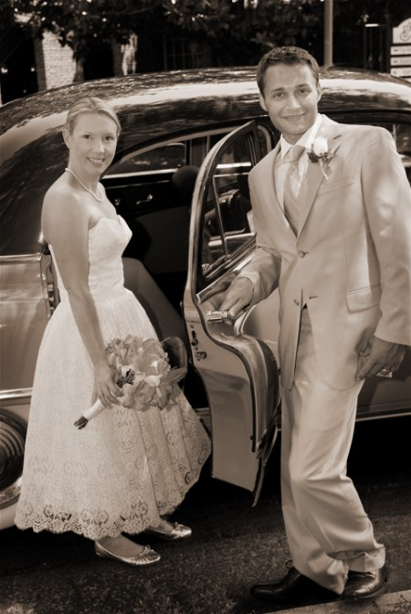 bride and groom get into a classic car