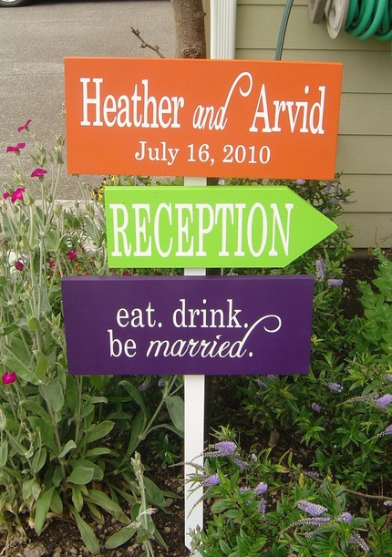 orange green and purple handmade wedding signs