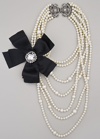 pearls with black satin bow