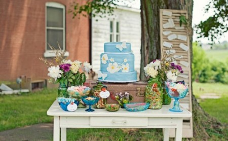 Blue wedding cake on rustic tablescape