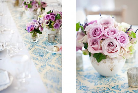 Blue damask table runner and pink rose centerpieces