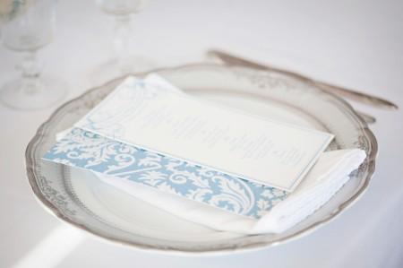 Blue damask invitations on vintage china plates