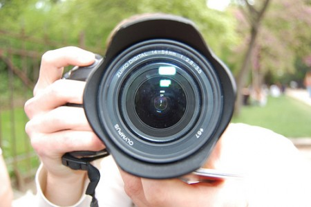 Closeup of a photographer taking a picture