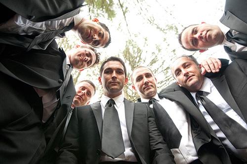 Seven Groomsmen in black tuxes