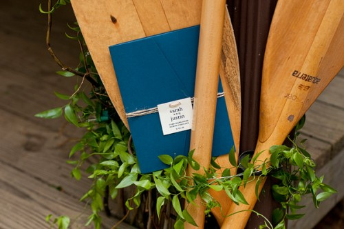 canoe paddle and wedding invitations