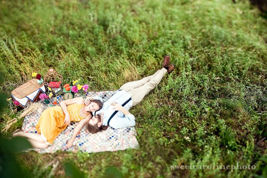 Engaged couple enjoy a picnic