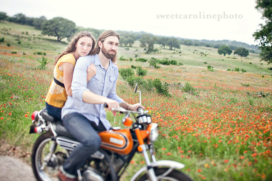 Engaged couple ride a vintage enduro dirtbike