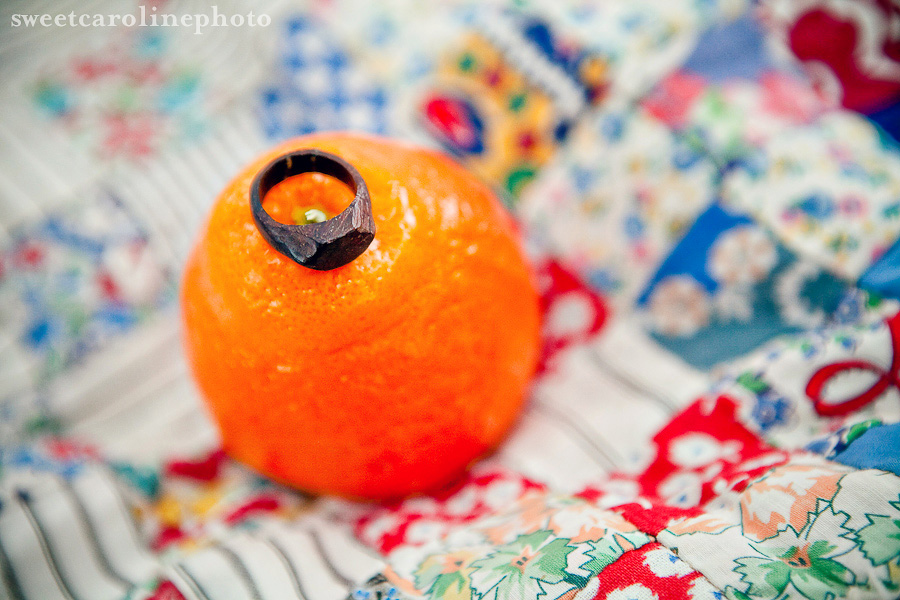 wooden engagement ring on top of vibrant orange