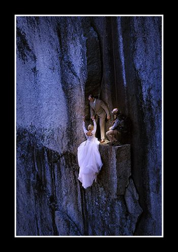 bride and groom rock climb