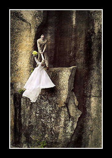 Groom holds on to bride rock climber