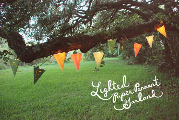 oragne green and yellow lanterns hang in a tree