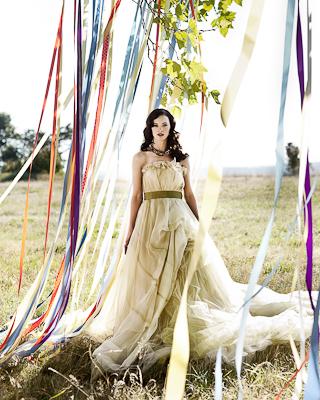 bride near streamers in a tree