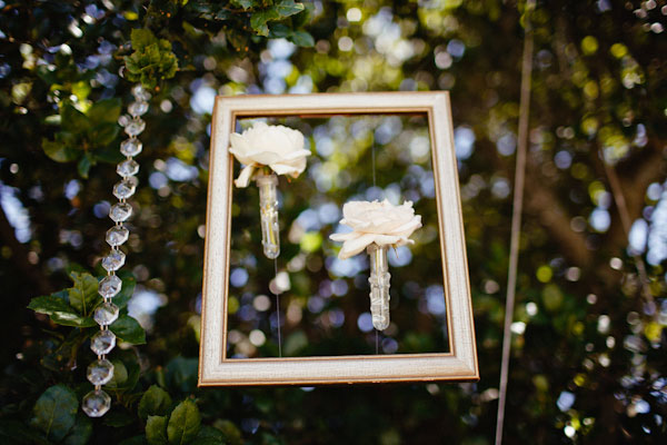 vases with flowers hand from vintage frames