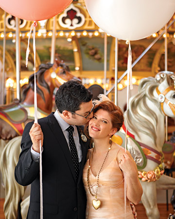 bride and groom on a merry-go-round