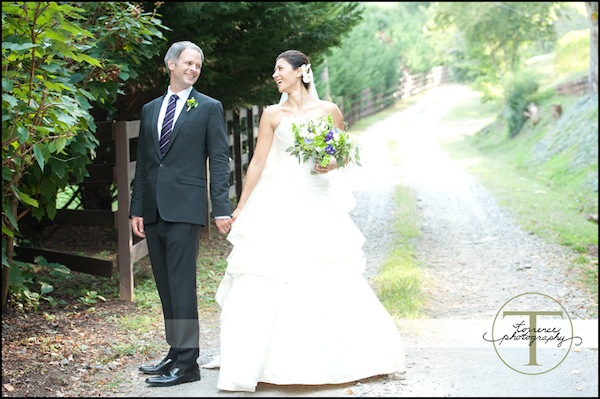 bride and groom on a country road