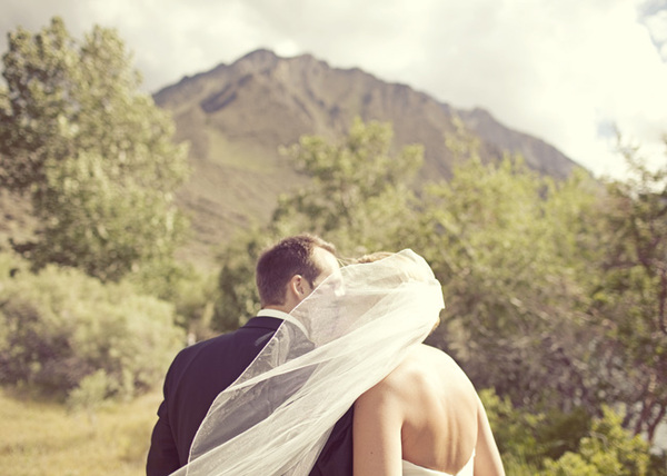 bride and groom in front of mountain