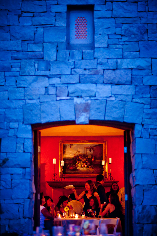 orange lit reception framed by a blue brick wall