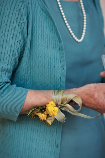 yellow corsage tied with blue ribbon