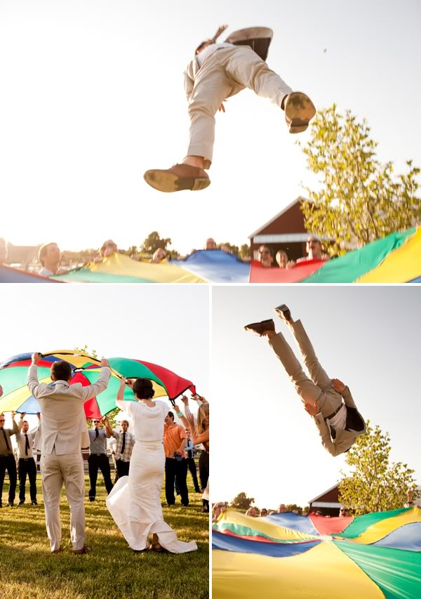 wedding guests playing games and jumping on a parachute