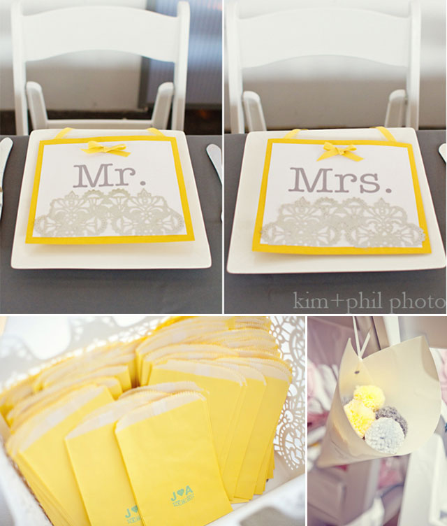 Preppy yellow and gray bride and groom place cards, yellow favor bags, and pale yellow and gray pom poms