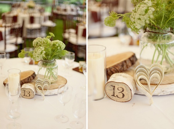wooden round, wildflower, and paper heart centerpieces