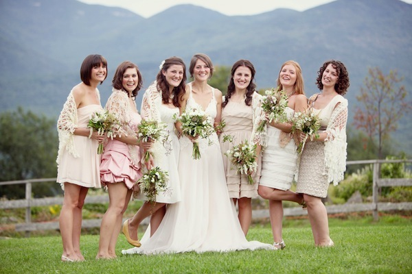 brides with bridesmaids in front of New Hampshire mountains