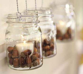 candles and acorns in mason jars
