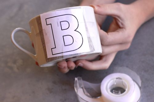 applying lettering on the mug