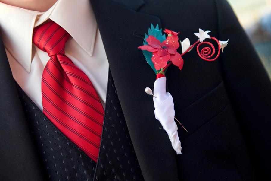 red white and teal paper boutonniere