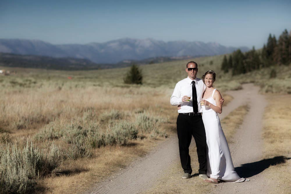 mammoth lakes bride and groom pose on an old mountain road