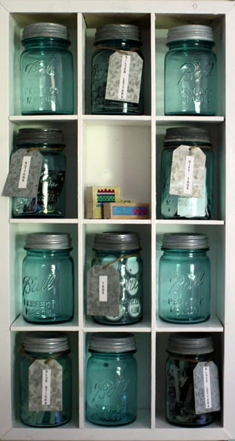 antique blue mason jars in a pantry