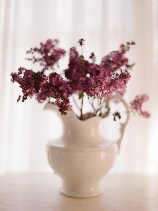 porcelain vase with magenta flowers