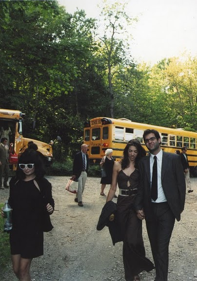 Guests arrive at a vermont wedding in school busses