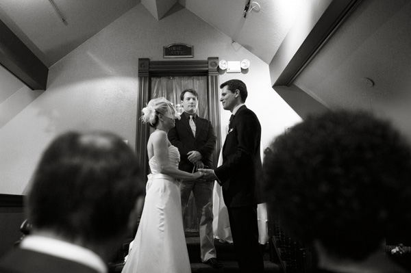 mountain couple exchanges wedding vows in an old church, black and white