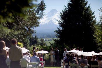 wedding ceremony site in the woods in front of Mount Hood