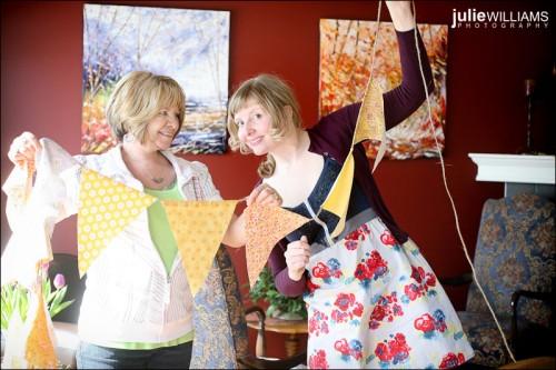 Julie holds up her wedding bunting