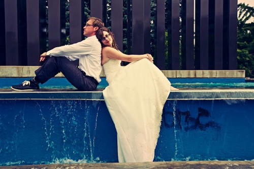 Bride and Groom trash the dress and tux in a public fountain