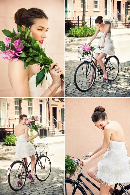 bride with a bun and a short wedding dress on a bicycle
