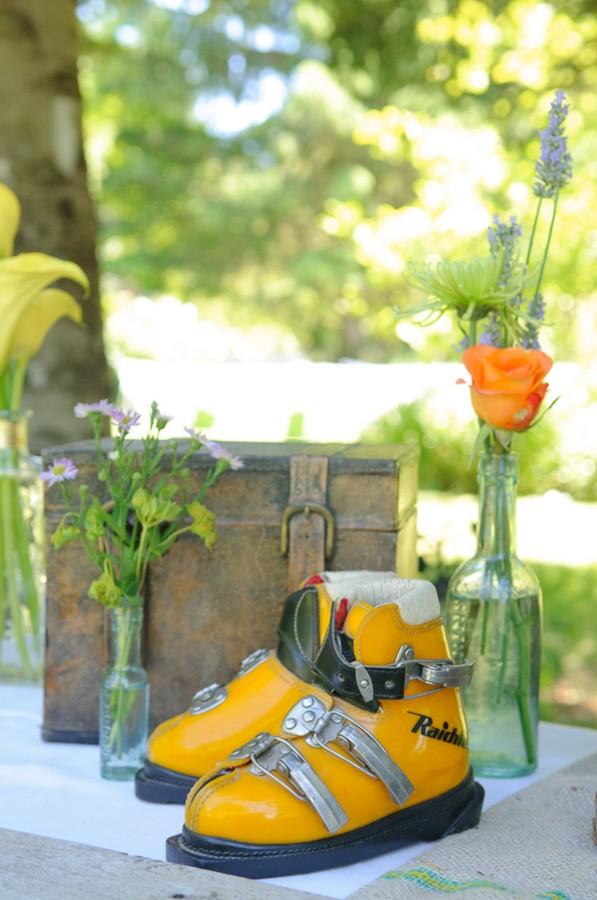 vintage orange ski boot used as wedding decor